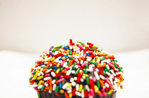Sprinkles on a cupcake. Photo credit.